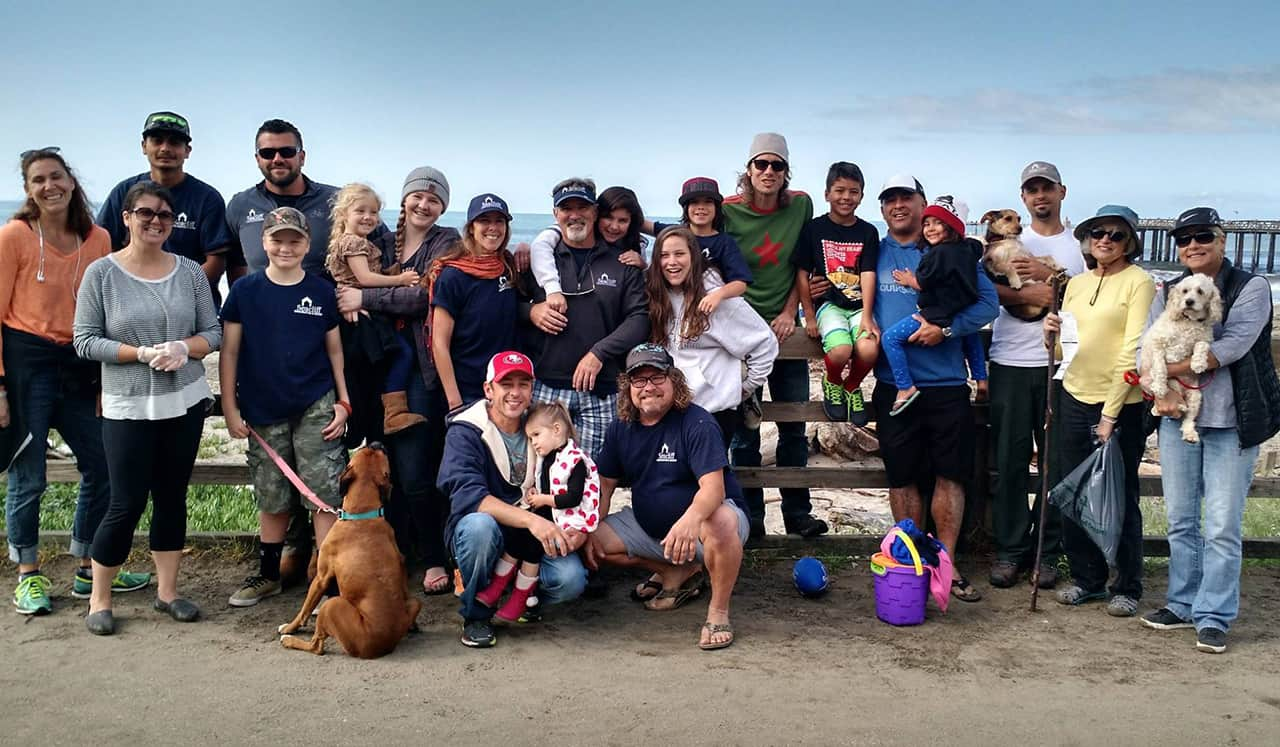 The extended Seacliff Construction and Design family after a community beach clean-up event.