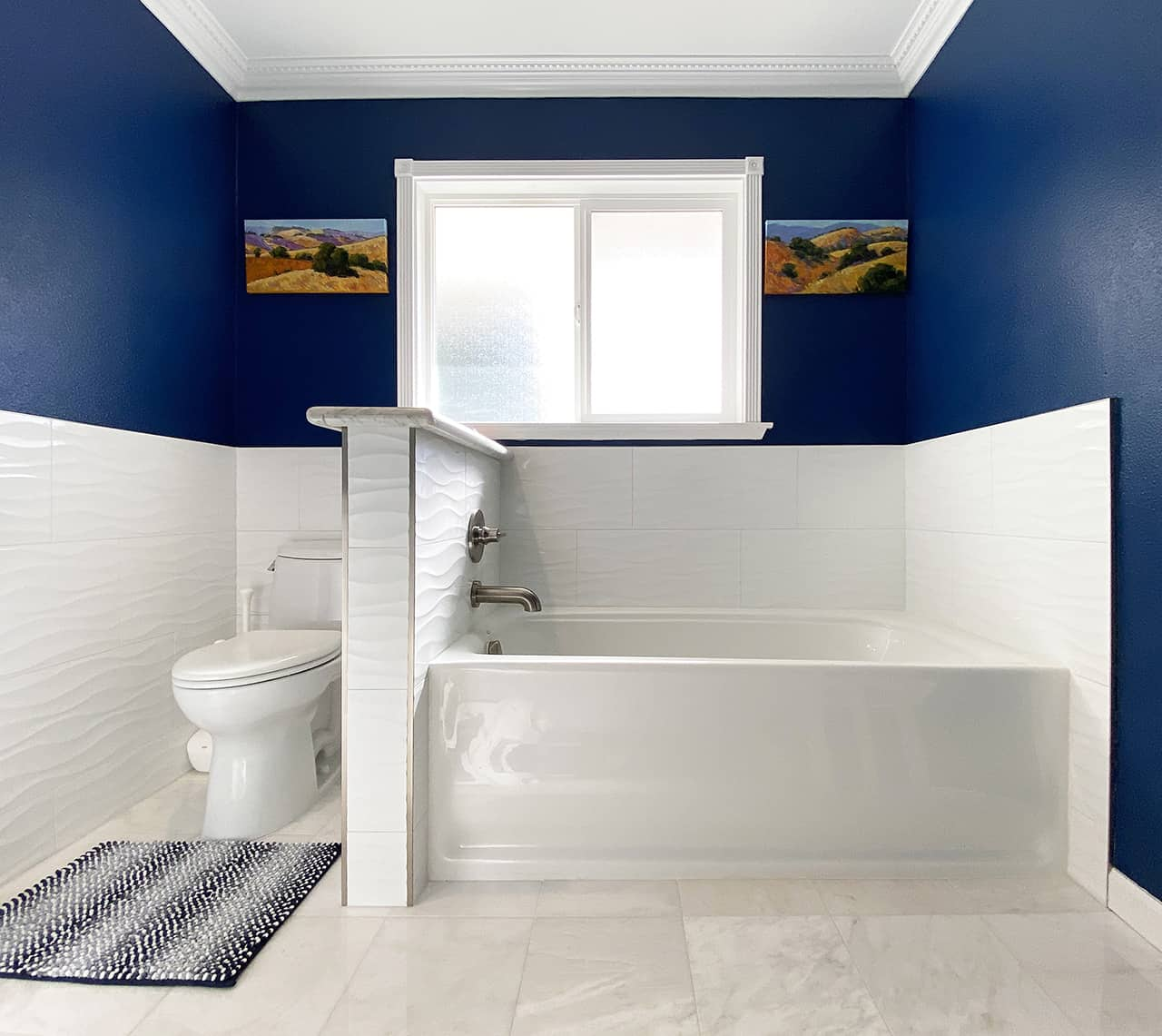 Stylish bathroom in blue and white